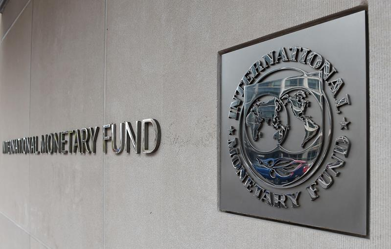 An exterior view of the building of the International Monetary Fund (IMF), with the IMG logo, is seen on March 27, 2020 in Washington, DC. (Photo by OLIVIER DOULIERY/AFP via Getty Images)