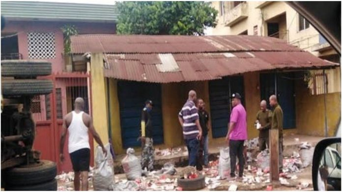 Tension As Truck Filled With Live Bullets Falls, Spills Content In Onitsha